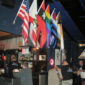 The corner of the bar, lots of flags, get your ...